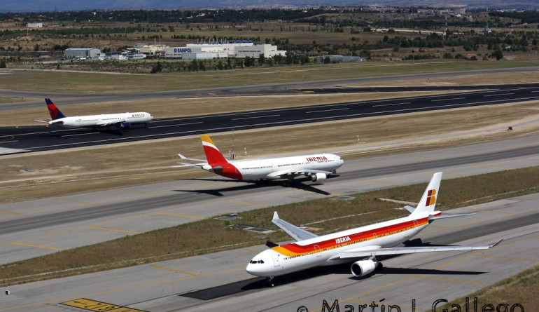 Two Iberias and one Delta operating on the Madrid airport runways